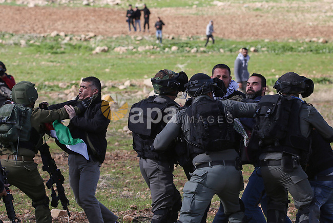 """Israeli soldiers arrest a Palestinian protester during a protest against US President Donald Trump's Century Deal """"expected peace plan"""", in the village of Atouf in the West Bank on January 31, 2020. Donald Trump has launched his """"ultimate deal"""" for Middle East peace, saying his detailed 80-page plan would be a """"realistic two-state solution"""" that had already been agreed to by Israel. Photo by Shadi Jarar'ah"""