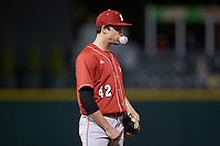 North Carolina State Wolfpack third baseman Tommy DeJuneas (42) blows a bubble with his gum while on defense during the game against the Charlotte 49ers at BB&T Ballpark on March 29, 2016 in Charlotte, North Carolina. The Wolfpack defeated the 49ers 7-1.  (Brian Westerholt/Four Seam Images)