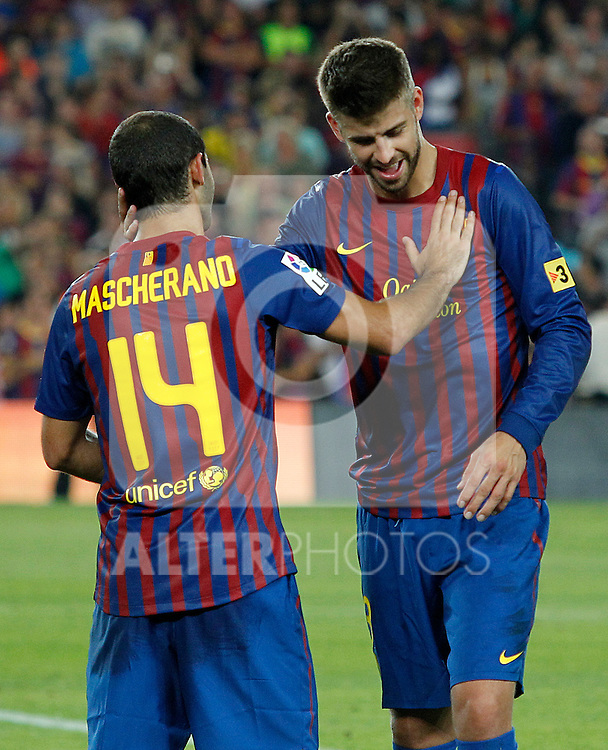FC Barcelona's Javier Mascherano and Gerard Pique celebrates the victory during Spanish Supercup 2nd match.August 17,2011. (ALTERPHOTOS/Acero)