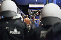 Switzerland. Canton Ticino. Lugano. Railway station. A group of police officers from TPO (Transport Police).  The policemen wear the special riot police black uniforms and helmets. They stand on the platform and control the FC Luzern football club's supporters before they leave in a chartered train. TPO (Transport Police) is the Swiss Federal Railways Police. Swiss Federal Railways (German: Schweizerische Bundesbahnen (SBB), French: Chemins de fer fédéraux suisses (CFF), Italian: Ferrovie federali svizzere (FFS)) is the national railway company of Switzerland. It is usually referred to by the initials of its German, French and Italian names, as SBB CFF FFS. 2.06.2017 © 2017 Didier Ruef