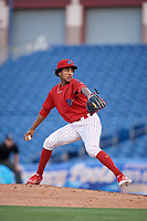 Clearwater Threshers starting pitcher Adonis Medina (18) delivers a pitch during a game against the Jupiter Hammerheads on April 12, 2018 at Spectrum Field in Clearwater, Florida.  Jupiter defeated Clearwater 8-4.  (Mike Janes/Four Seam Images)