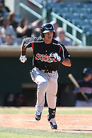 Alberth Martinez #21 of the Lake Elsinore Storm runs to first base during a game against the Lancaster JetHawks at The Hanger on April 6, 2014 in Lancaster, California. Lancaster defeated Lake Elsinore, 7-4. (Larry Goren/Four Seam Images)
