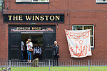 """© Joel Goodman - 07973 332324 . 28/08/2015 . Salford , UK . Tributes painted on a sheet outside The Winston pub on Churchill Way , near to St Paul's CE Church . The funeral of Paul Massey at St Paul's CE Church in Salford . Massey , known as Salford's """" Mr Big """" , was shot dead at his home in Salford last month . Photo credit : Joel Goodman"""