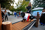 """Chelsea Mascari walks the """"catwalk"""" with Gunner during the Scallywaggers Pirate Pup Parade at the Brewery Arts Center, in Carson City, Nev., on Wednesday, Sept. 18, 2019.<br /> Photo by Cathleen Allison/Nevada Momentum"""