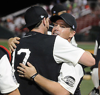 June 20, 2009: Greenville Drive manager Kevin Boles (19), right, hugs Mitch Dening (17) after the team won the first half Southern Division title for the South Atlantic League Saturday night with a 15-3 win over the Lexington Legends at Fluor Field at the West End in Greenville, S.C. Drive players were wearing Greenville Mill League throwback jerseys that were being auctioned off after the game. Photo by: Tom Priddy/Four Seam Images