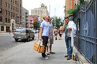 """Andrew Coté, beekeeper, Adam Johnson, a beginner and Troy Seidman, a curious friend, with their beekeeping material in front of a building with an apiary in the East Village. Adam says, """"It was an old desire, from childhood, but when CCD started in the United States, I really wanted to have beehives and start beekeeping. I have one hive and I take care of 4 others with Andrew in a community garden in the East Village."""""""
