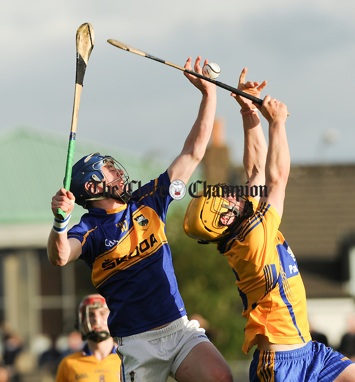 Alan Tynan of Tipperary in action against Darragh Walsh of Clare during their Munster Minor Championship game at Cusack Park. Photograph by John Kelly.