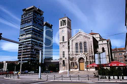 Sarajevo, Bosnia. Catholic church with modern office buildings.