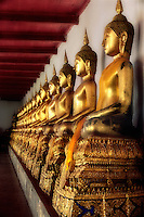 Gilded Buddha s in the gallery of Wat Mahathat. Bangkok, Thailand