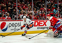 WASHINGTON, DC - JANUARY 31: Nick Jensen #3 of the Washington Capitals  guards the goal as Anders Lee #27 of the New York Islanders comes around during a game between New York Islanders and Washington Capitals at Capital One Arena on January 31, 2020 in Washington, DC.