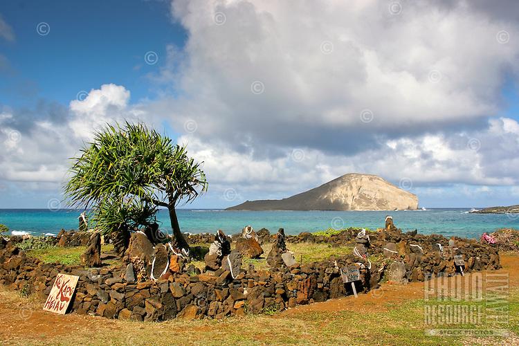 Sacred rocks at Ku Kapu Heiau along the Ka Iwi coastline (near Makapu'u),  Kalaniana'ole Highway, O'ahu; Manana (Rabbit) Island is in the distance.