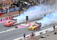 Oct 29, 2016; Las Vegas, NV, USA; NHRA funny car driver Jeff Arend (left) does a burnout alongside Bob Bode during qualifying for the Toyota Nationals at The Strip at Las Vegas Motor Speedway. Mandatory Credit: Mark J. Rebilas-USA TODAY Sports