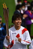 25th March 2021, Fukushima, Japan;  Iwashimizu Azusa, former member of Nadeshiko Japan, the Japan womens National Football Team, runs as one of torchbearers on the first day of the Tokyo 2020 Olympic torch relay in Futaba, Fukushima of Japan