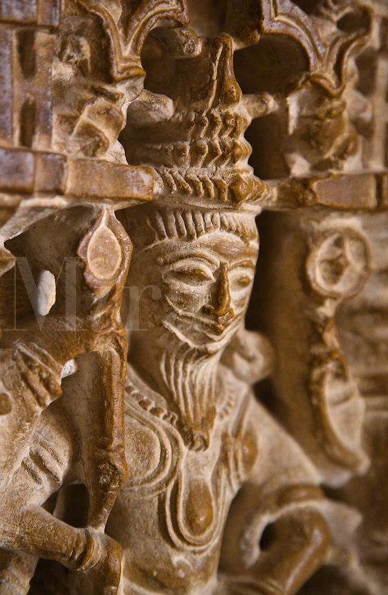 A hand carved sandstone statue of a leader in the CHANDRAPRABHU JAIN TEMPLE inside JAISALMER FORT - RAJASTHAN, INDIA.