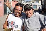 Two happy Guatemalan men on the street in Quetzaltenango, Guatemala
