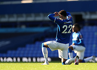 9th January 2021; Goodison Park, Liverpool, Merseyside, England; English FA Cup Football, Everton versus Rotherham United; Ben Godfrey of Everton takes a knee prior to the kick off