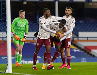 19th December 2020, Goodison Park, Liverpool, England;  Arsenals Nicolas Pepe celebrates after scoring an equalising goal from the penalty spot with teammates Ainsley Maitland-Niles and Dani Ceballduring the Premier League match between Everton FC and Arsenal FC