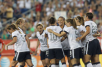 USWNT midfielder Carli Lloyd (10) celebrates her goal with teammates.  In an international friendly, the U.S. Women's National Team (USWNT) (white/blue) defeated Korea Republic (South Korea) (red/blue), 4-1, at Gillette Stadium on June 15, 2013.