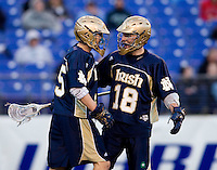Max Pfeifer (45) and Sean Rogers  (18) of Notre Dame celebrate a goal during the Face-Off Classic in at M&T Stadium in Baltimore, MD