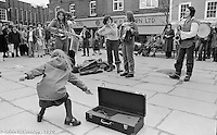 The York Street Band playing in York, March 1979.  Dena Attar on saxophone, Sarah Kemp on washboard, then the three members of the YSB: Ros Davies (saxophone), Sarha Moore (tambourine) and Anthea Gomez (accordian).  Sarha Moore and Ros Davies went on to play in The Bollywood Band, and Ros also joined the Grand Union Band, in London.  Anthea Gomez went on to write and play music for the theatre and then BBC Drama before changing direction.