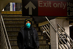 A subway rider wears a face mask in New York, U.S., on Thursday, March 19, 2020. New York state Governor Andrew Cuomo on Thursday ordered businesses to keep 75% of their workforce home as the number of coronavirus cases rises rapidly. Photograph by Michael Nagle/Redux