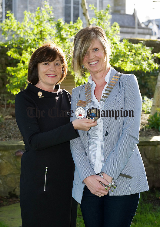 Stasia Mac Dermott, new president, Soroptimists International Ennis and District, right, accepting the chain of office from Deirdre Hughes, outgoing President 2010-2011. Photograph by John Kelly