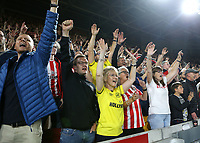 Brentford fans celebrate their victory at the final whistle during Brentford vs Liverpool, Premier League Football at the Brentford Community Stadium on 25th September 2021
