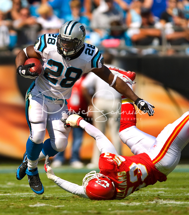 Carolina Panthers' Jonathan Stewart (28) runs the ball against Kansas City Chiefs linebacker Demorrio Williams (53) during a NFL football game at Bank of America Stadium in Charlotte, NC.