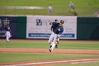Northwest Arkansas Naturals infielder Angelo Castellano (16) fields a ground ball on May 18, 2019, at Arvest Ballpark in Springdale, Arkansas. (Jason Ivester/Four Seam Images)
