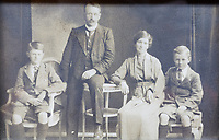 Pictured: Former store owner R D Ryder (2nd L) and R L Ryder (R) circa 1910 . <br /> Re: Shop owner Thomas Lewis Jones has made a Christmas advert starring Arthur Lewis Jones, his two-year-old son costing only £100.<br /> Hafod Hardware in Rhayader, Powys, has been making festive adverts for several years.<br /> This year's advert sees Arthur setting up the shop along with members of his family.