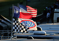 Oct 18, 2019; Ennis, TX, USA; An NHRA flag along with Texas, American and checkered flags fly during qualifying for the Fall Nationals at the Texas Motorplex. Mandatory Credit: Mark J. Rebilas-USA TODAY Sports