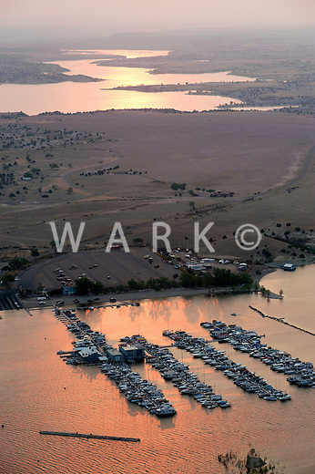 Lake Pueblo at sunset, air hazy due to nearby forest fires