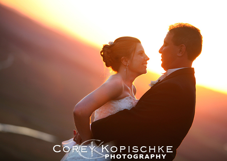 Bride and groom at sunset after wedding ceremony in Steamboat Colorado.