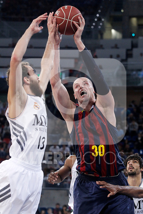 FC Barcelona's Maciej Lampe (r) and Real Madrid's Sergio Rodriguez during Supercopa ACB Final match.October 5,2013. (ALTERPHOTOS/Acero)