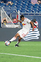 FOXBOROUGH, MA - MAY 22: Cristian Casseres Jr. #23 of New York Red Bulls passes the ball into the New England Revolution penalty box during a game between New York Red Bulls and New England Revolution at Gillette Stadium on May 22, 2021 in Foxborough, Massachusetts.