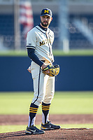 Michigan Wolverines pitcher Ben Dragani (21) looks to his catcher for the sign during the NCAA baseball game against the Illinois Fighting Illini at Fisher Stadium on March 19, 2021 in Ann Arbor, Michigan. Illinois won the game 7-4. (Andrew Woolley/Four Seam Images)