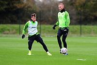 Tom Carroll vies for possession with Mike van der Hoorn of Swansea City during the Swansea City Training at The Fairwood Training Ground in Swansea, Wales, UK. Wednesday 30 October  2019