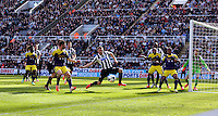 Pictured: Mathieu Debuchy of Newcastle (C) has a Swansea cross blocked. Saturday 19 April 2014<br /> Re: Barclay's Premier League, Newcastle United v Swansea City FC at St James Park, Newcastle, UK.