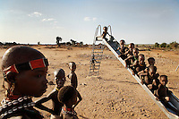 Save the Children fund gave a village a slide--a little bit of aid is distinctive AND HEAVILY USED in this harsh landscape.