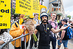 © Joel Goodman - 07973 332324 . 26/08/2017. Manchester , UK. Artist Brett Dearden , wearing a costume of a decommissioned riot helmet , shield and flowers in homage to a Banksy stencil , is rejected when he offers flowers to fundamentalist Christian protesters picketing the parade . 2017 Pride parade through Manchester City Centre . The annual festival , which is the largest of its type in Europe , celebrates LGBT life . Photo credit : Joel Goodman