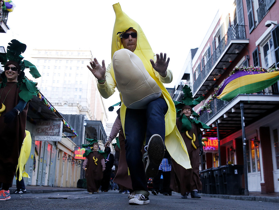 NEW ORLEANS, LOUISIANA - FEBRUARY 9, 2016:  A reveler dressed as a banana makes his way through the French Quarter during Mardi Gras day on February 9, 2016 in New Orleans, Louisiana. Fat Tuesday, or Mardi Gras in French, is a celebration traditionally held before the observance of Ash Wednesday and the beginning of the Christian Lenten season. (Photo by Jonathan Bachman/Getty Images)