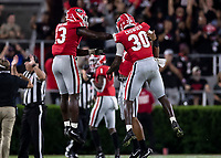ATHENS, GA - SEPTEMBER 21: Azeez Ojulari #13 of the Georgia Bulldogs and teammate Tae Crowder #30 celebrate after the Georgia victory during a game between Notre Dame Fighting Irish and University of Georgia Bulldogs at Sanford Stadium on September 21, 2019 in Athens, Georgia.