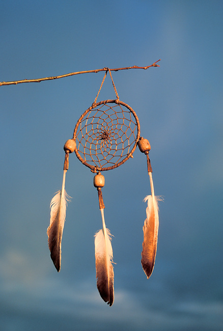 According to legend, the dreamcatcher catches all dreams, good and bad. Bad dreams are trapped in the web until dawn and burn up. Good dreams find their way to the small hole in the center and and flow into the feathers, where they stay until dreamed another night. Property released