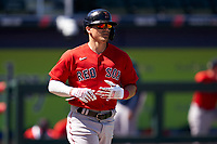 Boston Red Sox Enrique Hernández (5) jogs to first base during a Major League Spring Training game against the Atlanta Braves on March 7, 2021 at CoolToday Park in North Port, Florida.  (Mike Janes/Four Seam Images)