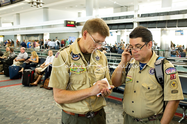 Photo story of Philmont Scout Ranch in Cimarron, New Mexico, taken during a Boy Scout Troop backpack trip in the summer of 2013. Photo is part of a comprehensive picture package which shows in-depth photography of a BSA Ventures crew on a trek. In this photo,  Assiatant Scout Masters confirm the charter bus transporting the  venture crew Philmont Scout Ranch, Cimarron, New Mexico, after landing at the Denver International Airport.<br /> <br /> Photo by travel photograph: PatrickschneiderPhoto.com
