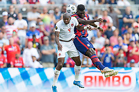 KANSAS CITY, KS - JULY 18: Daryl Dike #11 of the United States battle in the air during a game between Canada and USMNT at Children's Mercy Park on July 18, 2021 in Kansas City, Kansas.