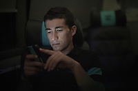 Sergio Henao (COL/SKY)  checking his (team)phone after the last stage in Madrid<br /> <br /> stage 21: Alcala de Henares - Madrid (98km)<br /> 2015 Vuelta à Espana