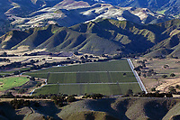 aerial photograph of farming in the Santa Ynez Valley mountains in spring, Santa Barbara County, California