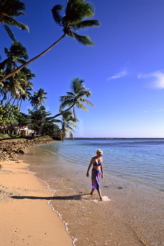 Blonde Tourist at Sheraton Hotel Beach with Palms Nadi Bay Area in the Fiji Islands