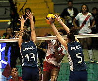 BOGOTÁ-COLOMBIA, 07-01-2020: Blanca Farriol y Lucia Fresco de Argentina, intenta un bloqueo al ataque de balón, a Angela Leyva de Perú, durante partido entre Argentina y Perú, en el Preolímpico Suramericano de Voleibol, clasificatorio a los Juegos Olímpicos Tokio 2020, jugado en el Coliseo del Salitre en la ciudad de Bogotá del 7 al 9 de enero de 2020. / Blanca Farriol and Lucia Fresco from Argentina, tries to block the attack the ball to Angela Leyva from Peru, during a match between Argentina and Peru, in the South American Volleyball Pre-Olympic Championship, qualifier for the Tokyo 2020 Olympic Games, played in the Colosseum El Salitre in Bogota city, from January 7 to 9, 2020. Photo: VizzorImage / Luis Ramírez / Staff.